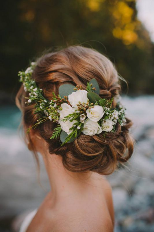 Wreath of flowers in bride's hair by Confetti Floral